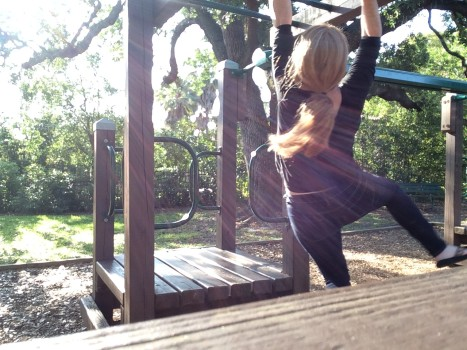 Using the monkey bars as practice.