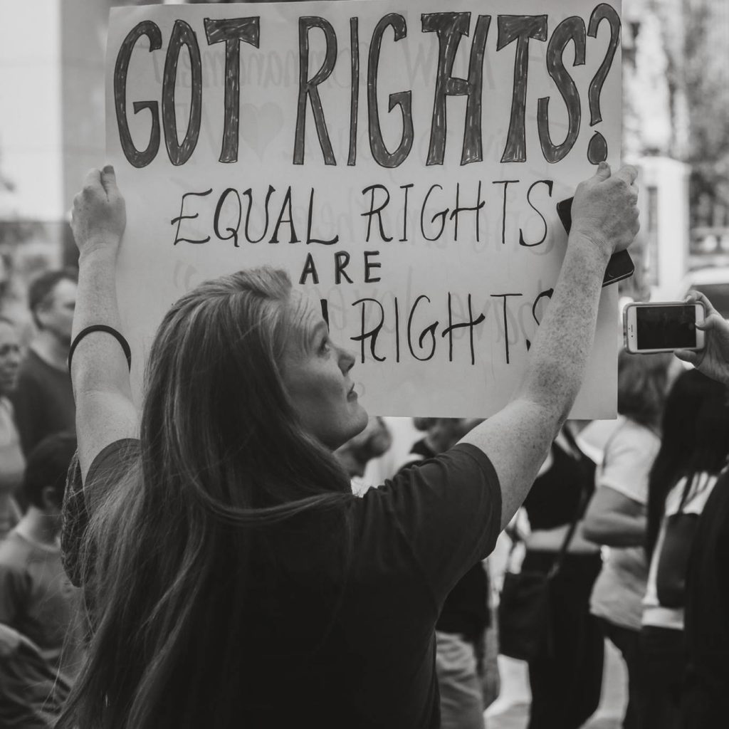Woman holding equal rights poster at womens march